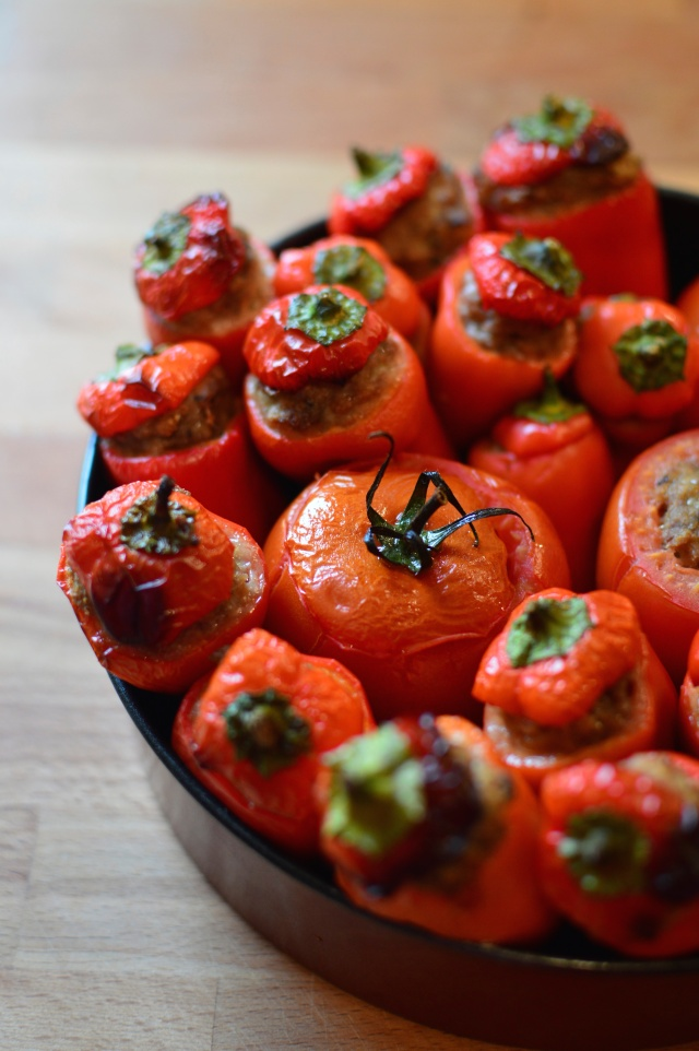 Roasted stuffed peppers and tomatoes